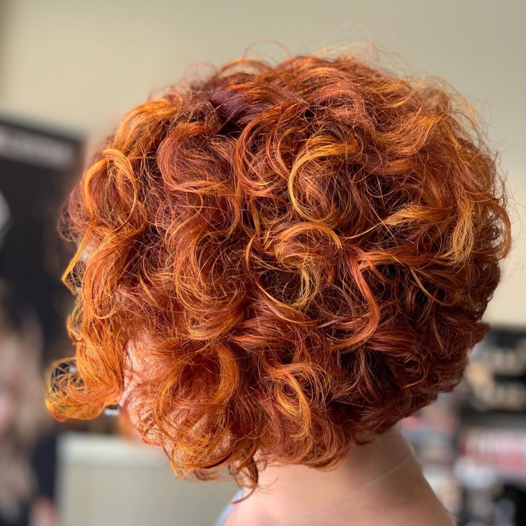 Redhead natural curls bright and fun short haircut - Milwaukee's Best Hair Salon - veronica's hair studio