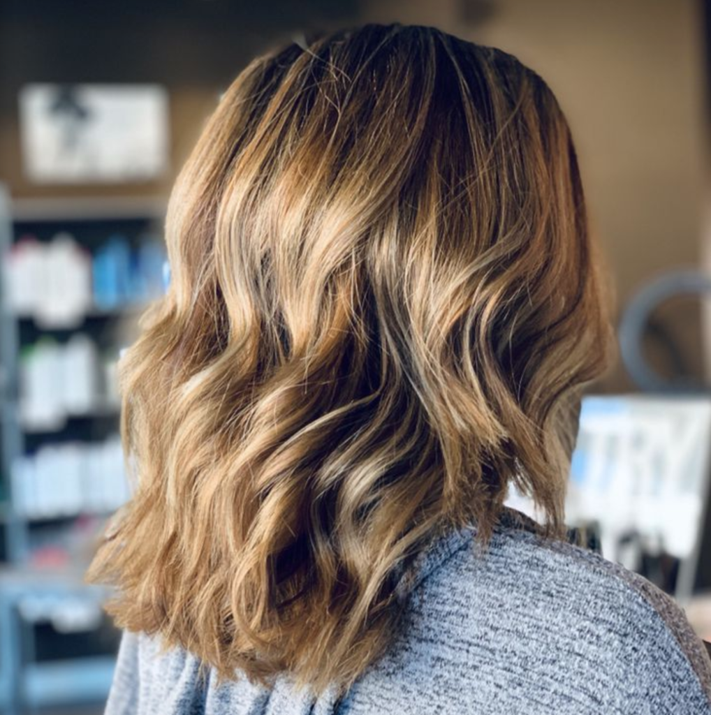 Blonde wavy haircut with highlights - Milwaukee's Best Hair Salon - veronica's hair studio